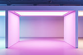 Minimalistic gallery interior with color backlight and blank on wall.