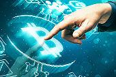 Hand using blue bitcoin interface