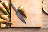 Bamboo shoot prepare for cooking on wooden board