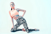 Sporty fit girl in stylish sportswear in neon light. Leggings for effective workout, healthy sport lifestyle, copy space