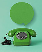 Vintage telephone with speech bubble