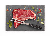 Raw beef steak with seasoning