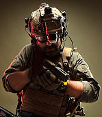 Special forces operator with gun