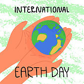 International Earth Day banner. A person carefully hold Planet Earth on palms of the hands, textured background. Green environment, uniting to fight with ecological disaster, global climate changing