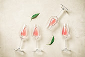 Glasses with rose wine flat lay on a concrete background. View from above.