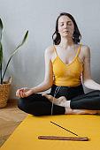 European caucasian woman practicing yoga