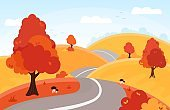 Autumn landscape. Forest and fields.  Country road through golden color hills.
