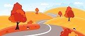 Autumn landscape. Country road through golden color hills.