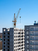 Construction crane for lifting and mounting panels, blocks in the construction of residential buildings, high-rises