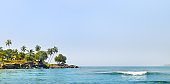 Tropical beach and beautiful palm trees. The concept is travel. Wide photo.