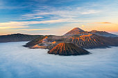 Bromo volcano mountain at sunrise in East Java, Indonesia surrounded by morning fog.