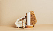 Tube of cream or cosmetic serum modern abstract podium of natural materials