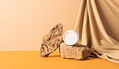 Cosmetics cream jar modern abstract podium trendy yellow background draped cloth