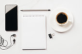 Notepad blank for to-do list or goals coffee cup office supplies stationery