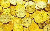 Heap of golden bitcoins background