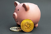 Piggy bank with coins of bitcoin. Close up.