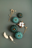 Collection of handmade plaster pumpkins. Autumn seasonal holidays background