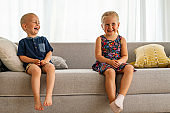 Happy children girl and boy having fun, playing together. Child, fun, parenting concept