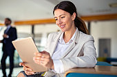 Attractive businesswoman using a digital tablet in office