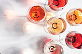 Rose wine glass on gray table. Pink rosado, rosato or blush wine tasting in wineshop, bar concept. Copy Space
