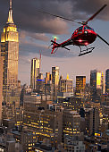 Helicopter tour over Manhattan at night .