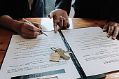 Real estate agent offer hand for customer sign agreement contract signature for buy or sell house. Real estate concept contact agreement concept - selective focus.