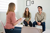 Therapist giving advice to a young couple