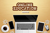 Online education vector design. Online education text with laptop, phone and tablet device elements in wooden background for home school educational learning.