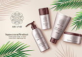 Sunscreen cosmetic product vector banner. Sunscreen mock up bottle element of whitening lotion, ultra sunscreen and sun protection cream for summer skin care advertising products with green leaf elements in brown background.