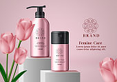 Cosmetic mock up vector banner template. Feminine care products in pink elegant bottles packaging with tulip flower background design for advertisement purposes.