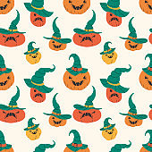 Halloween pumpkins seamless pattern vector illustration. Squashes with spooky faces texture design.