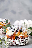 Easter cake kraffin. Craffins with raisins, candied fruits and sprinkled with powdered sugar. Close-up of homemade pie. Cruffin.
