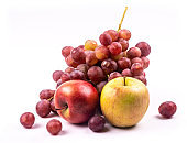 Bunch of grapes and apples on white background