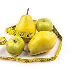 Apple and pear with measuring tape isolated