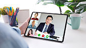 Virtual video conference, Work from home, Brainstorm planing teamwork, Asian business team making video call by web, Group of asia team online telecommunication meeting by digital tablet