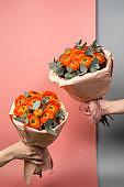 A bouquet of bright orange ranunculus close-up.