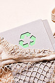Mesh bags and reusable notepad with green recycling sign