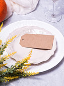 Autumn table setting with a brown craft paper card.