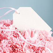 Empty tag in a bouquet of carnations.