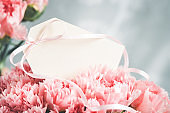Blank tag in a bouquet of carnations.