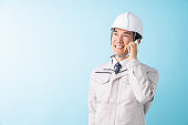 middle age construction Worker ,telephone