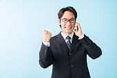 middle age businessman who talks on the telephone
