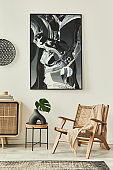 Stylish scandinavian living room interior of modern apartment with wooden commode, design armchair, carpet, leaf in vase and personal accessories in unique home decor. Template.