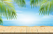 Empty wood table, summer beach with blue sea and sky background