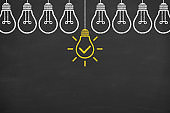 Creative idea solution concepts with light bulbs on a chalkboard background