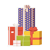 Pile of colorful wrapped gift boxes decorated ribbon