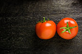 Top view of Tomatoes on black background.