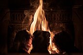 Household fire of peat briquettes