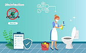 Disinfective housekeeping service. cleaning maid holding alcohol spraying on toilets. Idea for disinfection cleaning to protect from COVID-19
