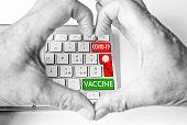 Coronavirus pandemic, vaccine. Human hand make heart shape on keyboard computer, optimist for future
